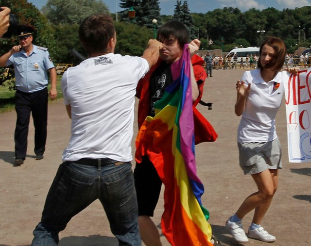 An anti-gay protester clashes with a gay rights activist during a Gay Pride event in St. Petersbur