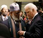 United States Vice President Biden greets Imam Sheikh Roble at roundtable on countering violent extremism in Washington
